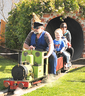 Mini Fell Train Carnival, Featherston,Saturday, train driver Peter Gibbs emerges from the tunnel