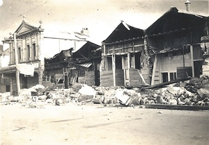 The badly damaged Chemist Shop and four of George Pain's  buildings. Note the fire blackened eaves.