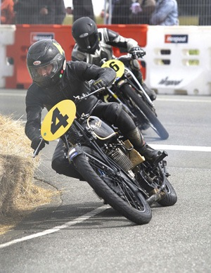 Bill leads a fellow 'Velo Fellow' through a corner. Photo courtesy  John Cosgrove Photography.